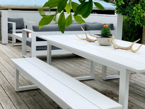 matching white outdoor table and sofa