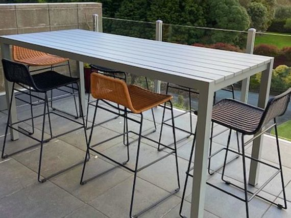 long outdoor bar table set for modern home