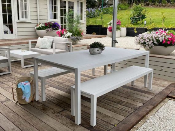 modern white outdoor dining table and benches